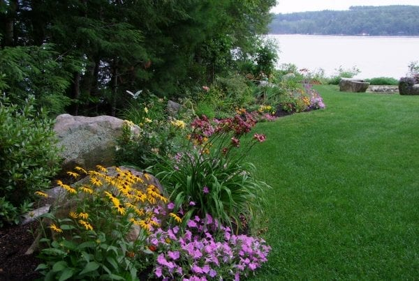 Lakefront landscaping by Belknap Landscape Co.