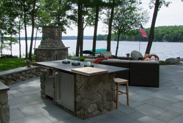 Outdoor Kitchen, Patio and Fireplace by Belknap Landscape Co.